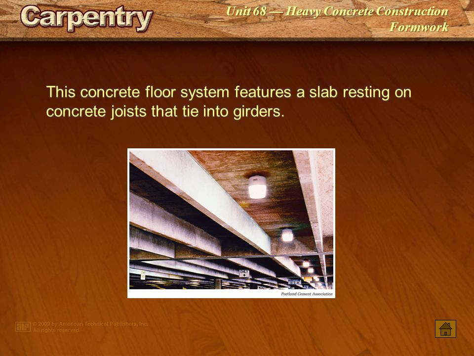 This concrete floor system features a slab resting on concrete joists that tie into girders.