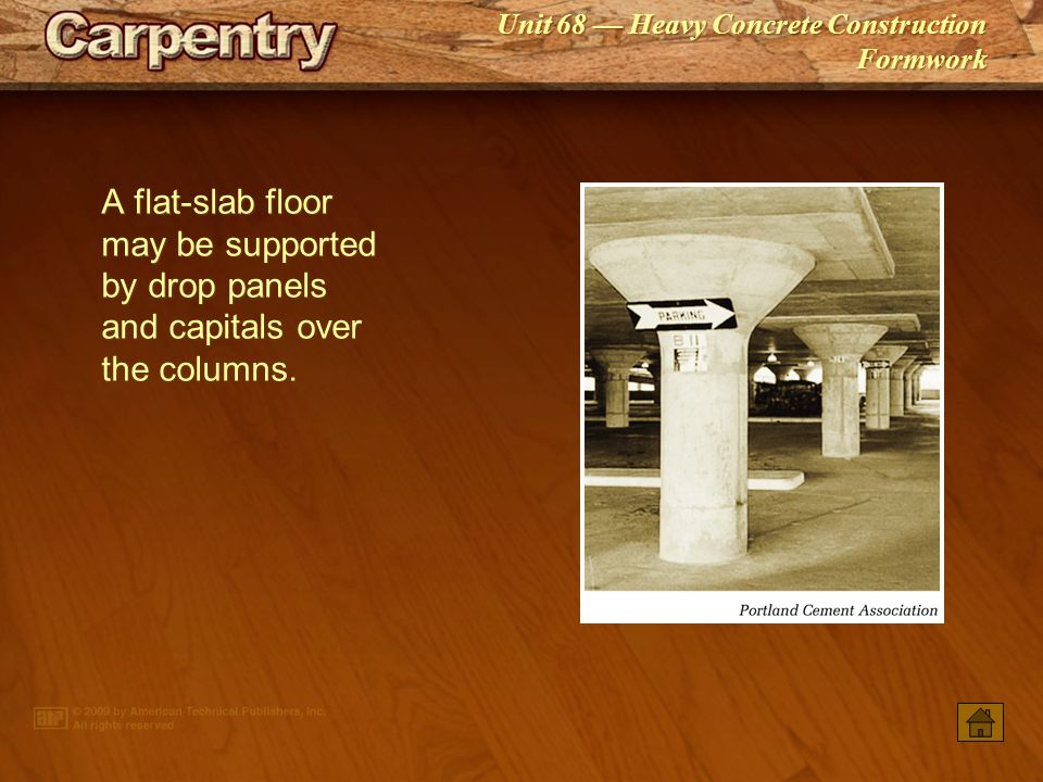 A flat‑slab floor may be supported by drop panels and capitals over the columns.