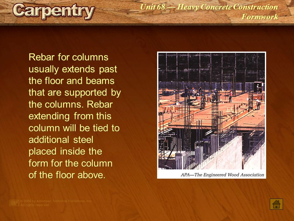 Rebar for columns usually extends past the floor and beams that are supported by the columns. Rebar extending from this column will be tied to additional steel placed inside the form for the column of the floor above.