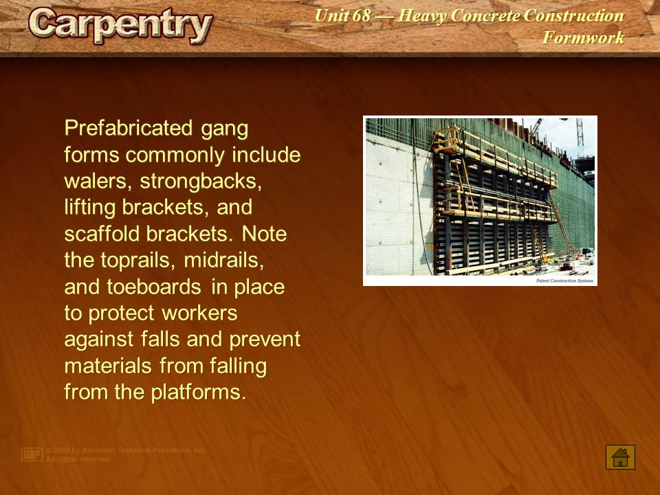 Prefabricated gang forms commonly include walers, strongbacks, lifting brackets, and scaffold brackets. Note the toprails, midrails, and toeboards in place to protect workers against falls and prevent materials from falling from the platforms.