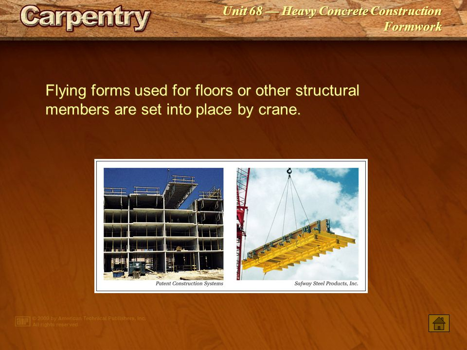 Flying forms used for floors or other structural members are set into place by crane.