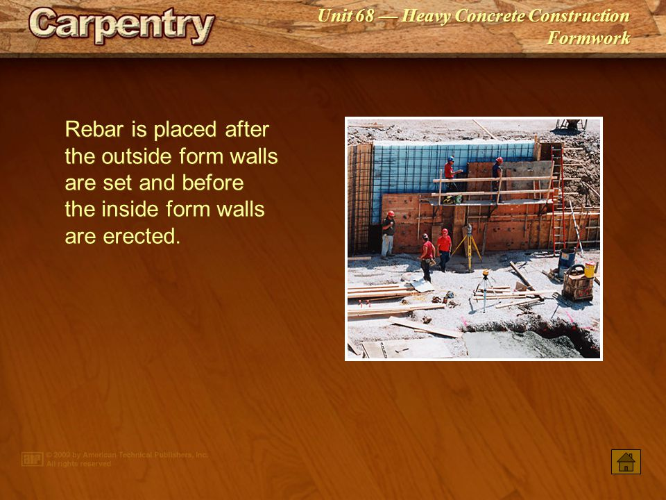 Rebar is placed after the outside form walls are set and before the inside form walls are erected.