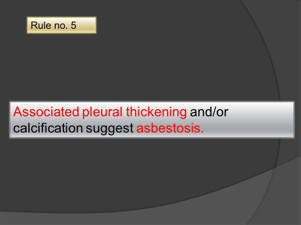 Associated pleural thickening and/or calcification suggest asbestosis.