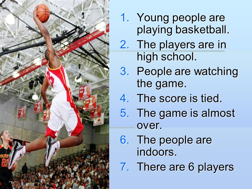 Young people are playing basketball.