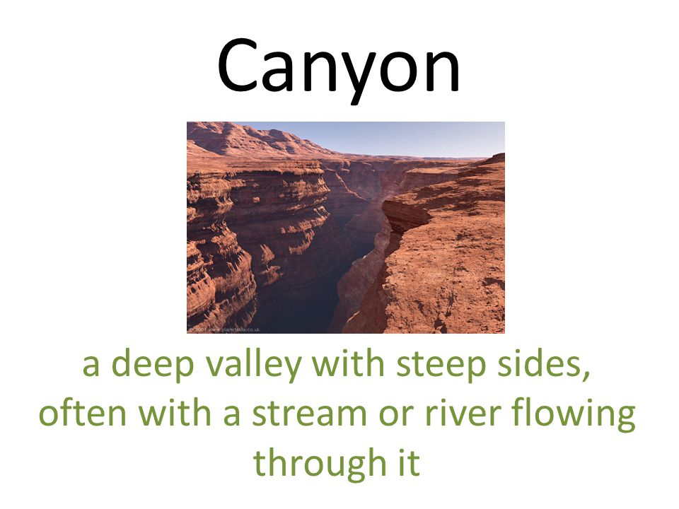 Canyon a deep valley with steep sides, often with a stream or river flowing through it