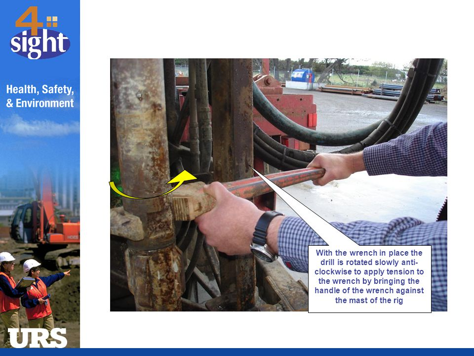 With the wrench in place the drill is rotated slowly anti-clockwise to apply tension to the wrench by bringing the handle of the wrench against the mast of the rig