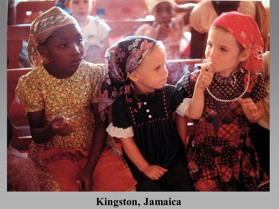 Kingston, Jamaica *Young Rastafarian Church members smoke Ganja