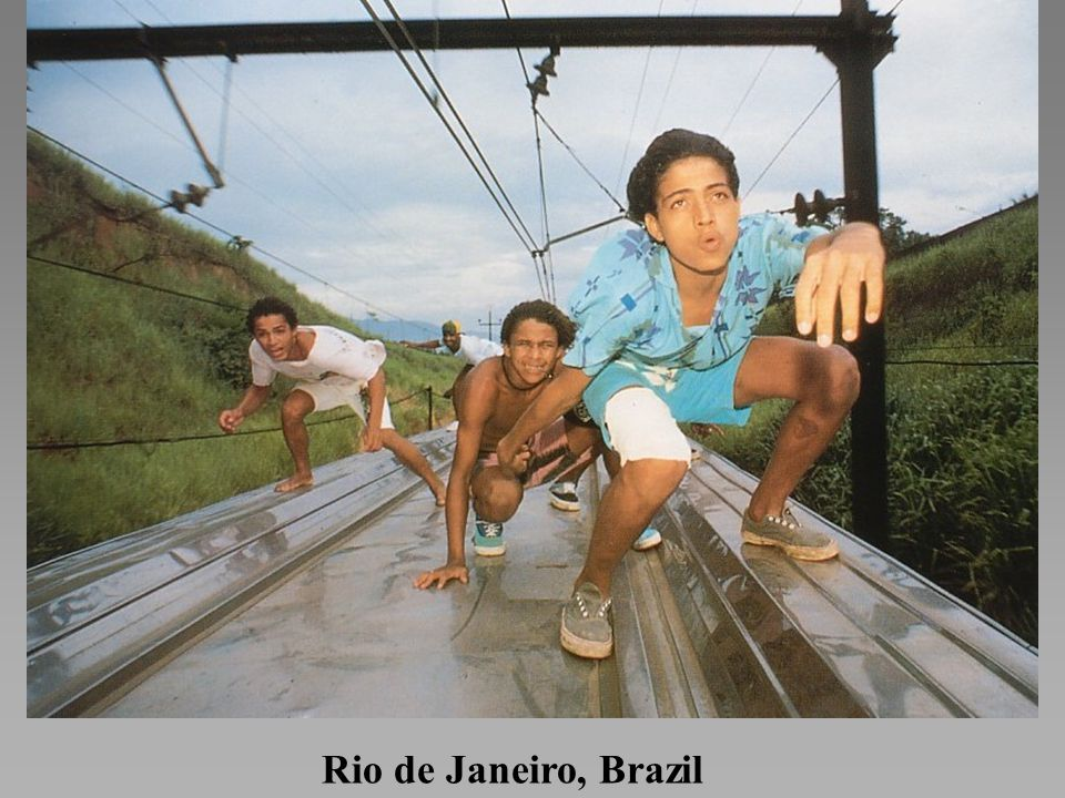 *Teenage surfistas ride atop speeding trains swerving through the hills of Rio. If they touch the electric lines or fail to duck at the right moment, they risk serious injury or death.