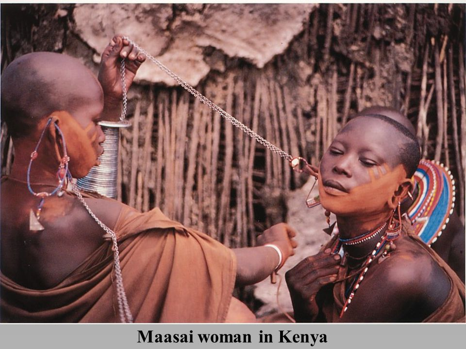*A Maasai woman in Kenya has her head shaved and her body painted with occre in preparation for marriage.