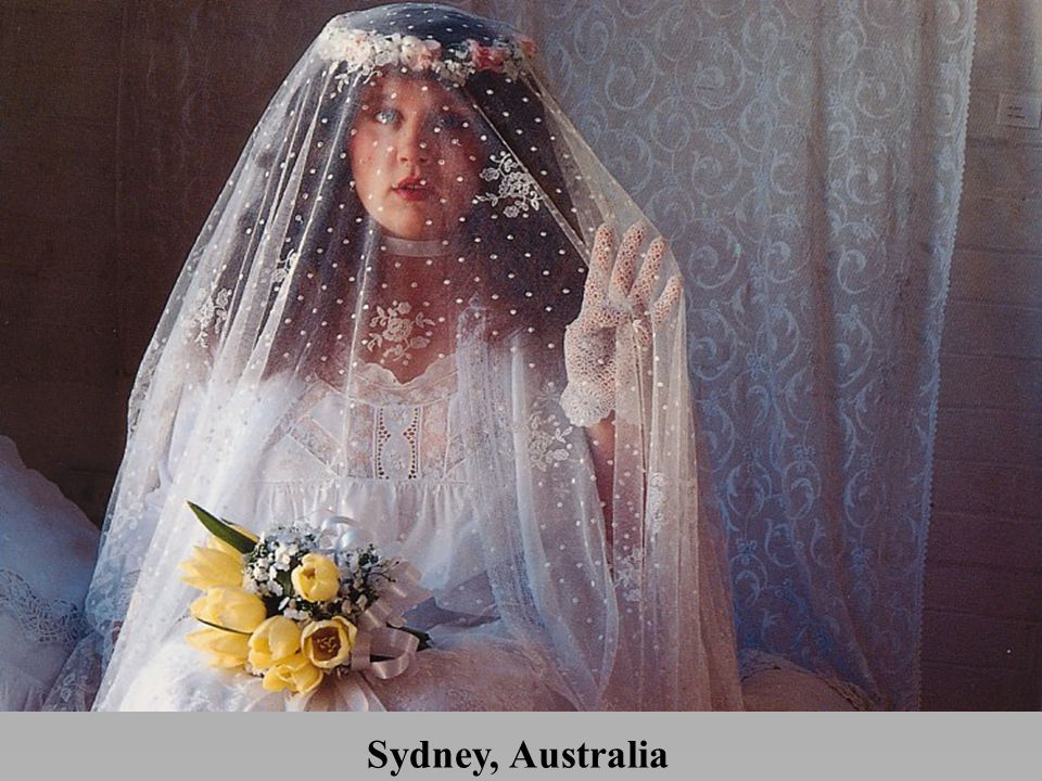 *In Sydney, a young woman covers her face with a wedding veil to mark her status as a bride