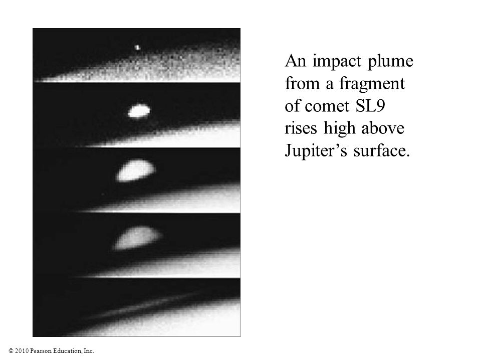 An impact plume from a fragment of comet SL9 rises high above Jupiter's surface.