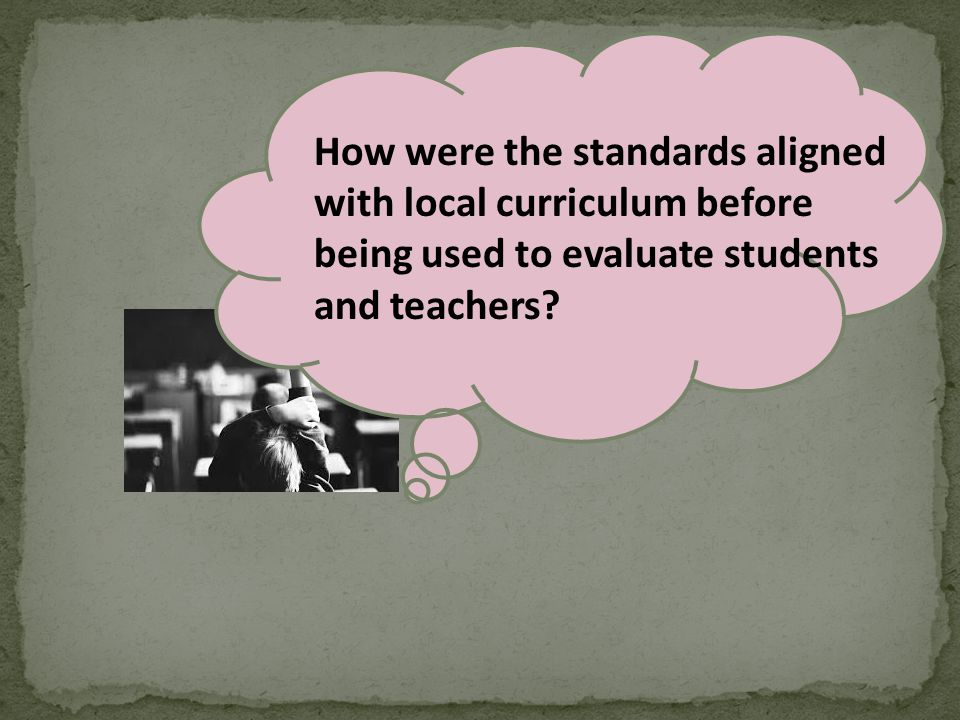 How were the standards aligned with local curriculum before being used to evaluate students and teachers