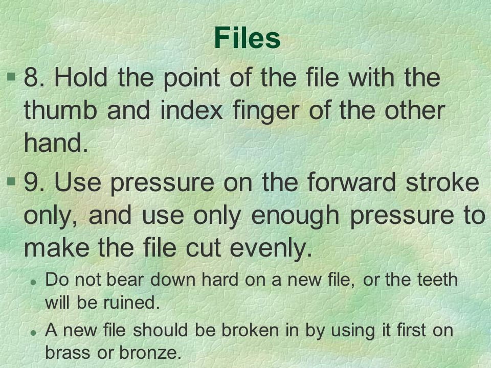 Files 8. Hold the point of the file with the thumb and index finger of the other hand.