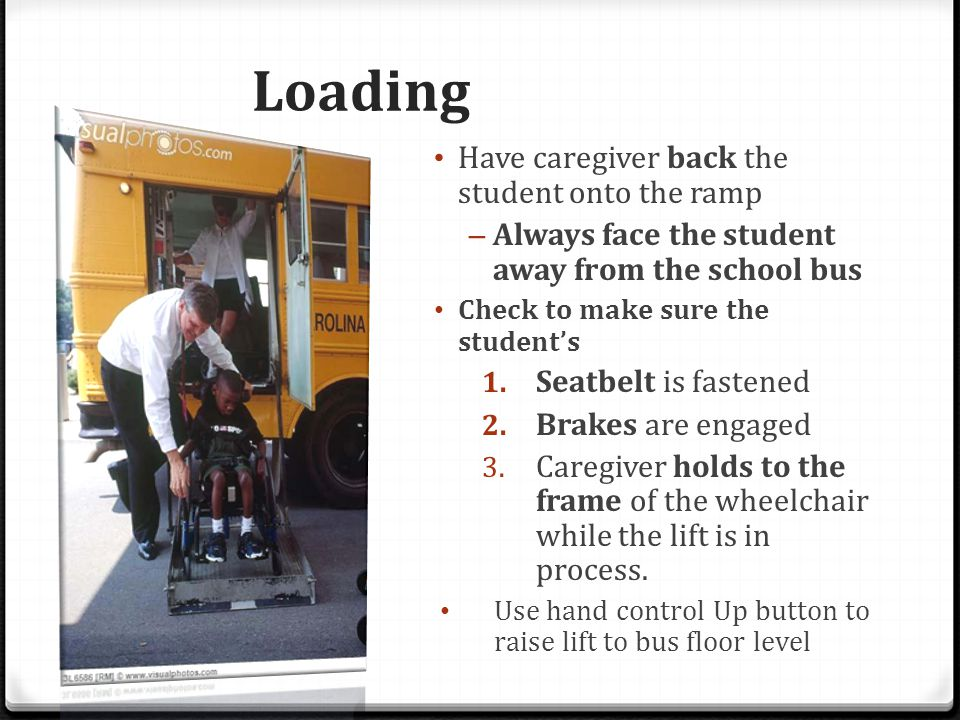 Loading Have caregiver back the student onto the ramp