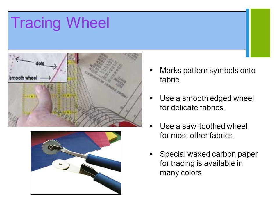 Tracing Wheel Marks pattern symbols onto fabric.