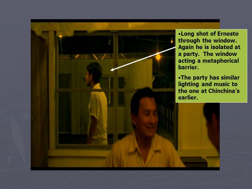 Long shot of Ernesto through the window