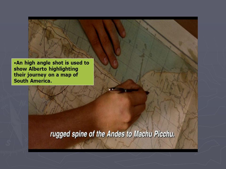 An high angle shot is used to show Alberto highlighting their journey on a map of South America.