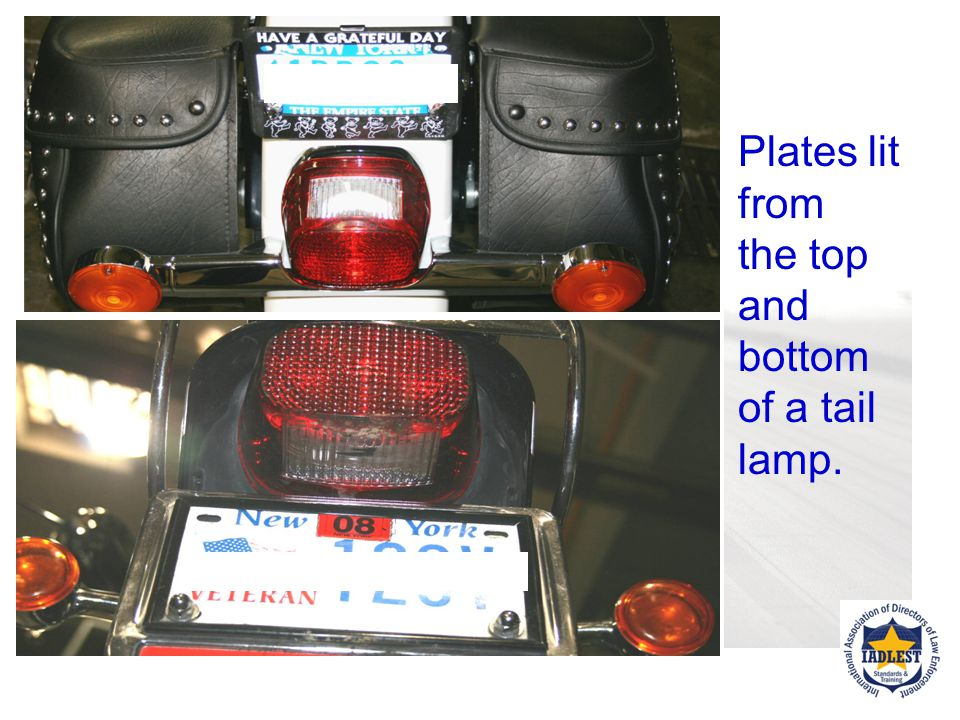 Plates lit from the top and bottom of a tail lamp.