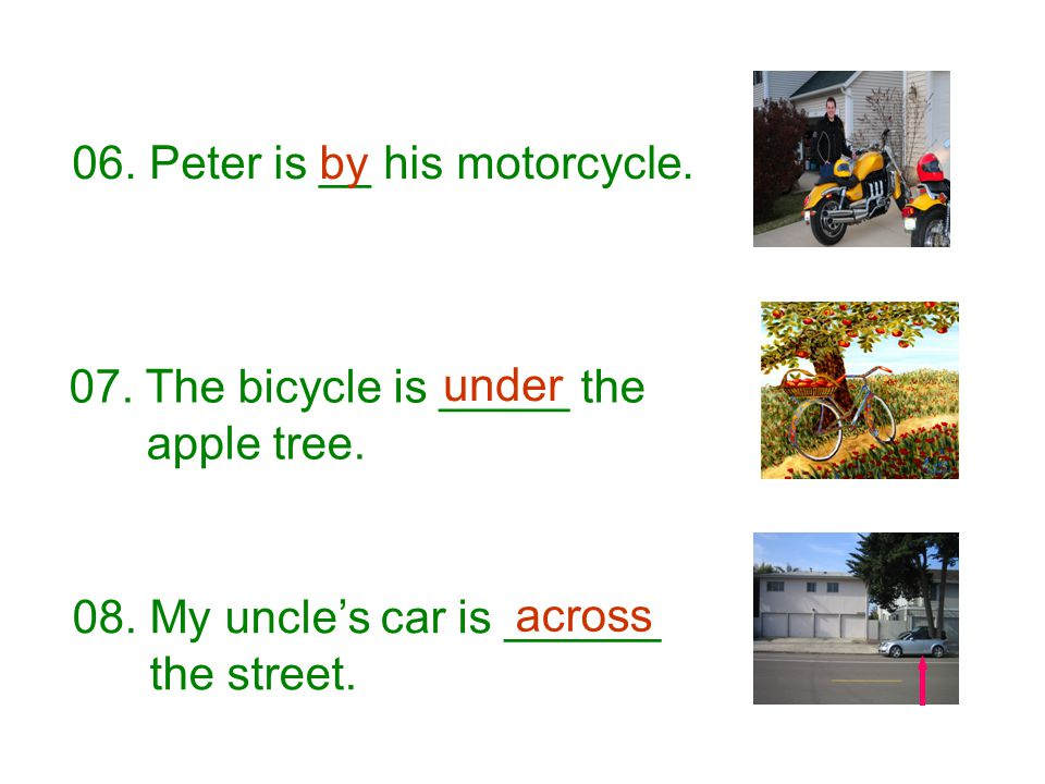 06. Peter is __ his motorcycle.