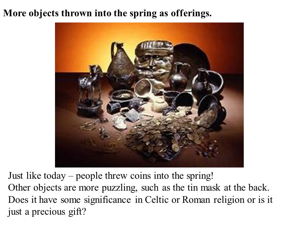 More objects thrown into the spring as offerings.