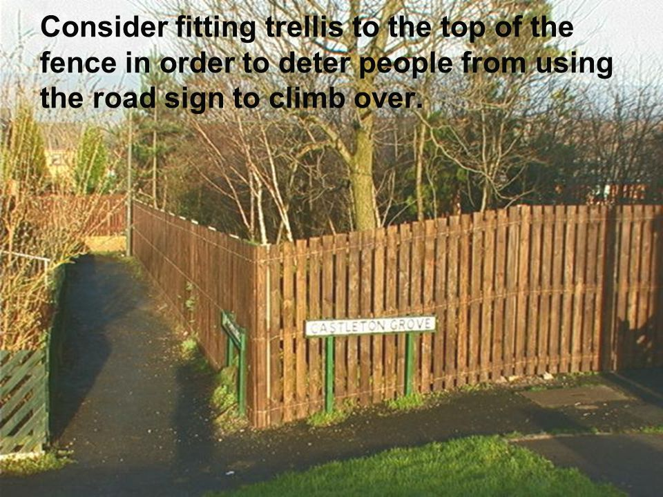 Consider fitting trellis to the top of the fence in order to deter people from using the road sign to climb over.