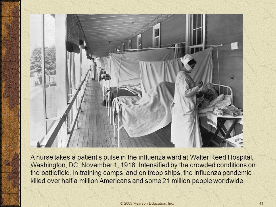 A nurse takes a patient's pulse in the influenza ward at Walter Reed Hospital, Washington, DC, November 1, 1918. Intensified by the crowded conditions on the battlefield, in training camps, and on troop ships, the influenza pandemic killed over half a million Americans and some 21 million people worldwide.