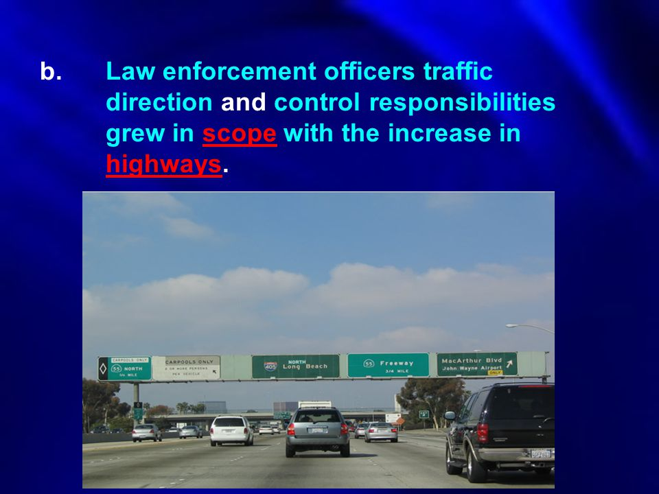 b. Law enforcement officers traffic. direction and control