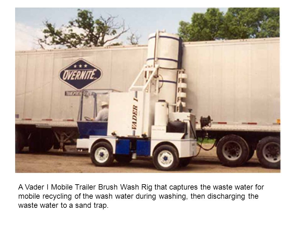 A Vader I Mobile Trailer Brush Wash Rig that captures the waste water for mobile recycling of the wash water during washing, then discharging the waste water to a sand trap.