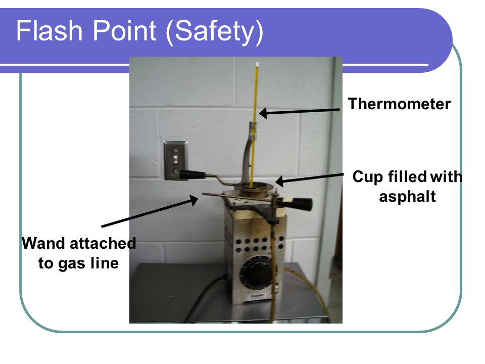 Cup filled with asphalt Wand attached to gas line