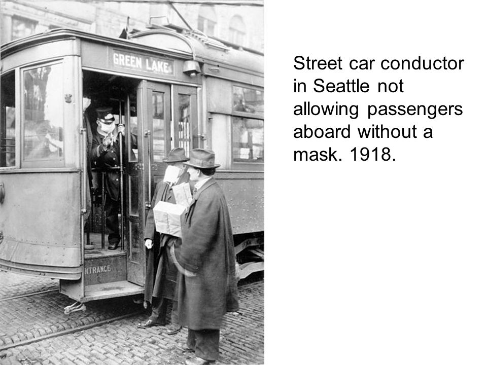 Street car conductor in Seattle not allowing passengers aboard without a mask. 1918.