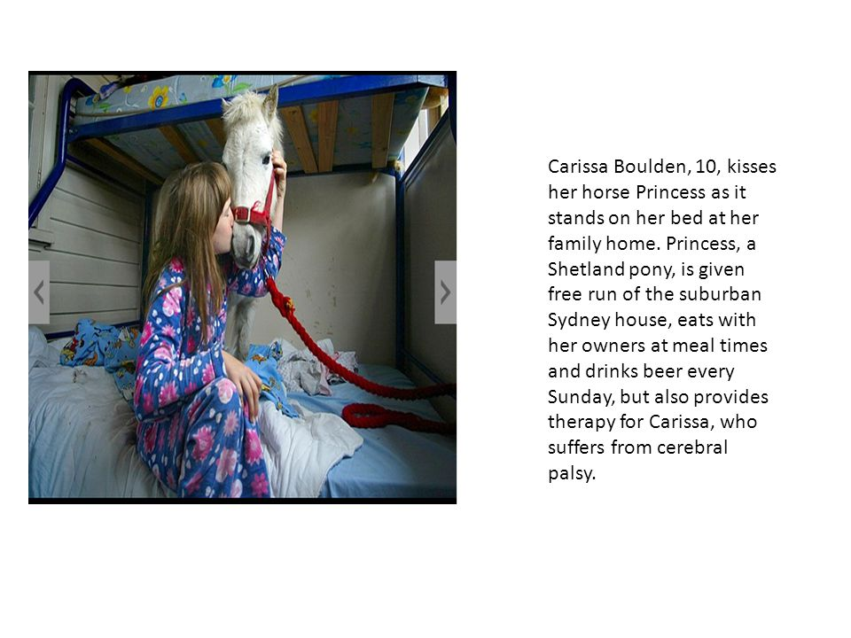 Carissa Boulden, 10, kisses her horse Princess as it stands on her bed at her family home.