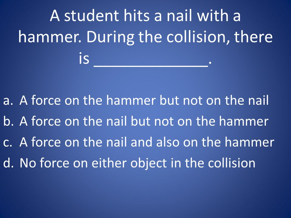 A student hits a nail with a hammer