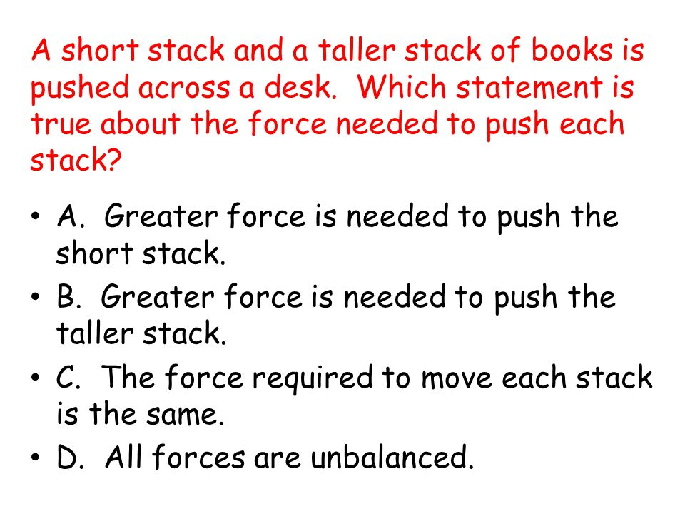 A short stack and a taller stack of books is pushed across a desk