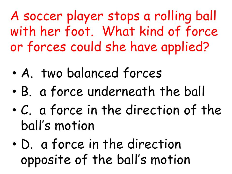 A soccer player stops a rolling ball with her foot