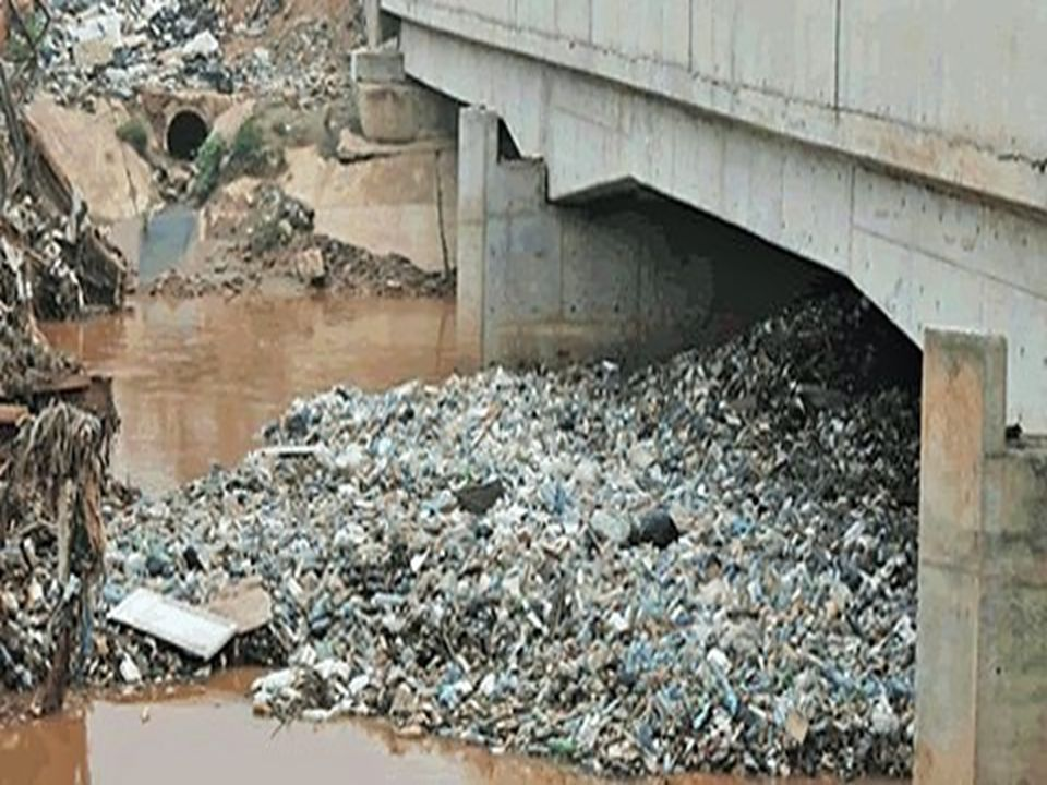 Improper waste management leading to reduced drainage capacity