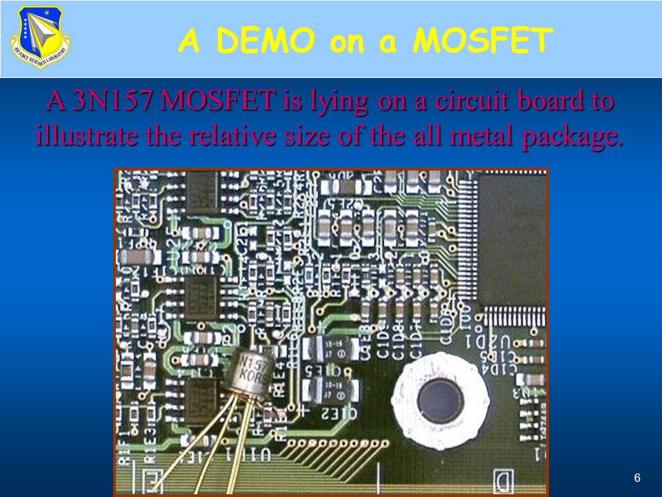 A DEMO on a MOSFET A 3N157 MOSFET is lying on a circuit board to