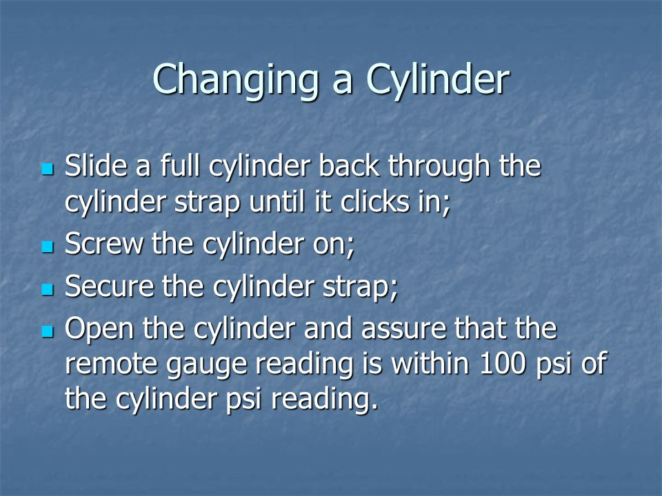 Changing a Cylinder Slide a full cylinder back through the cylinder strap until it clicks in; Screw the cylinder on;