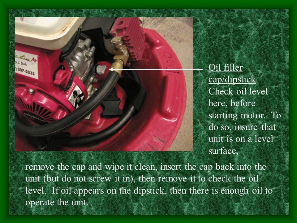 Oil filler cap/dipstick. Check oil level here, before starting motor