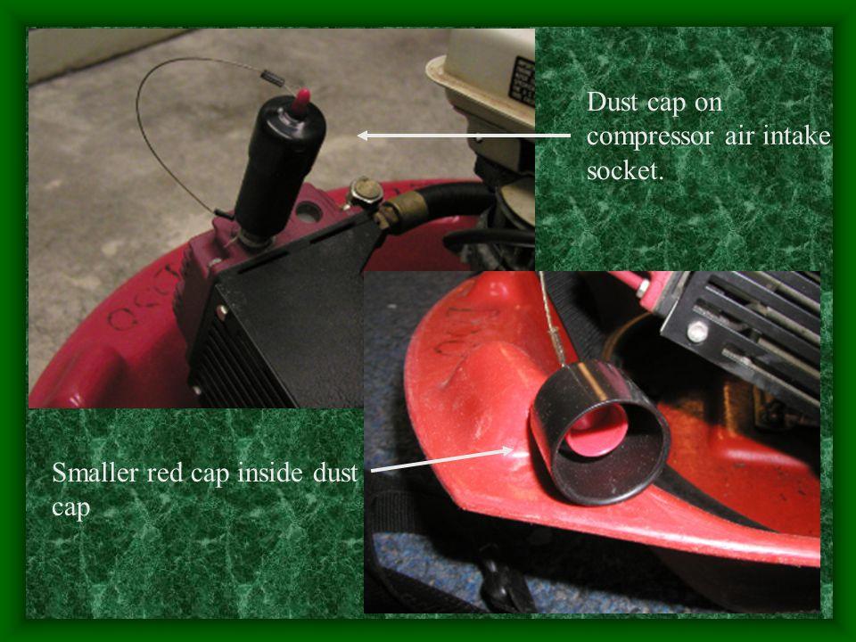 Dust cap on compressor air intake socket.