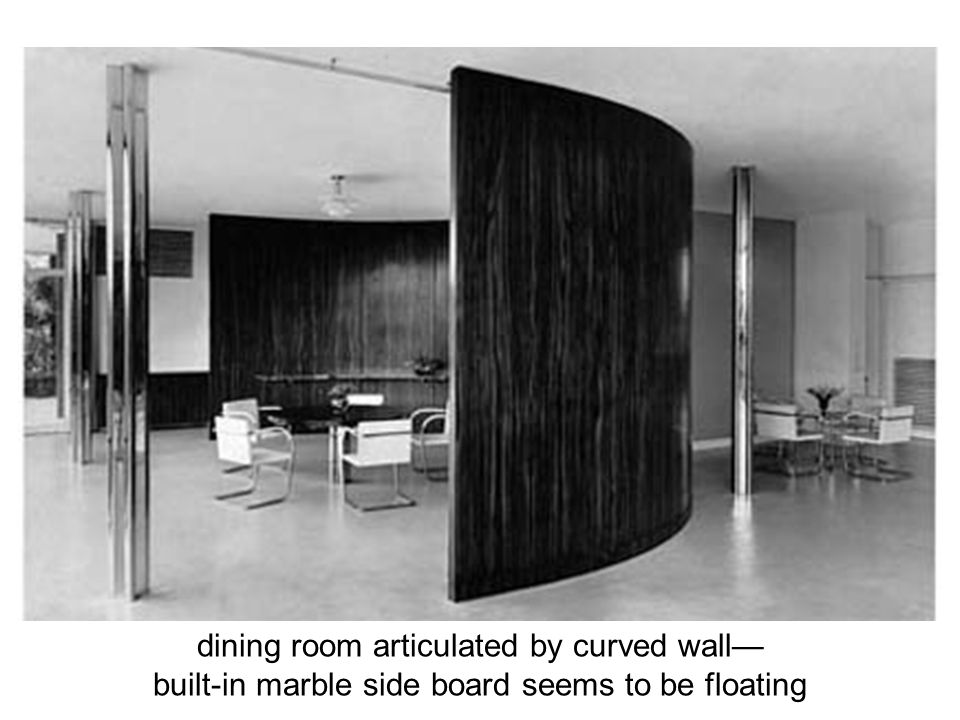 dining room articulated by curved wall—