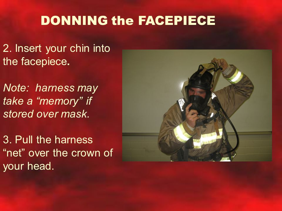 DONNING the FACEPIECE 2. Insert your chin into the facepiece.