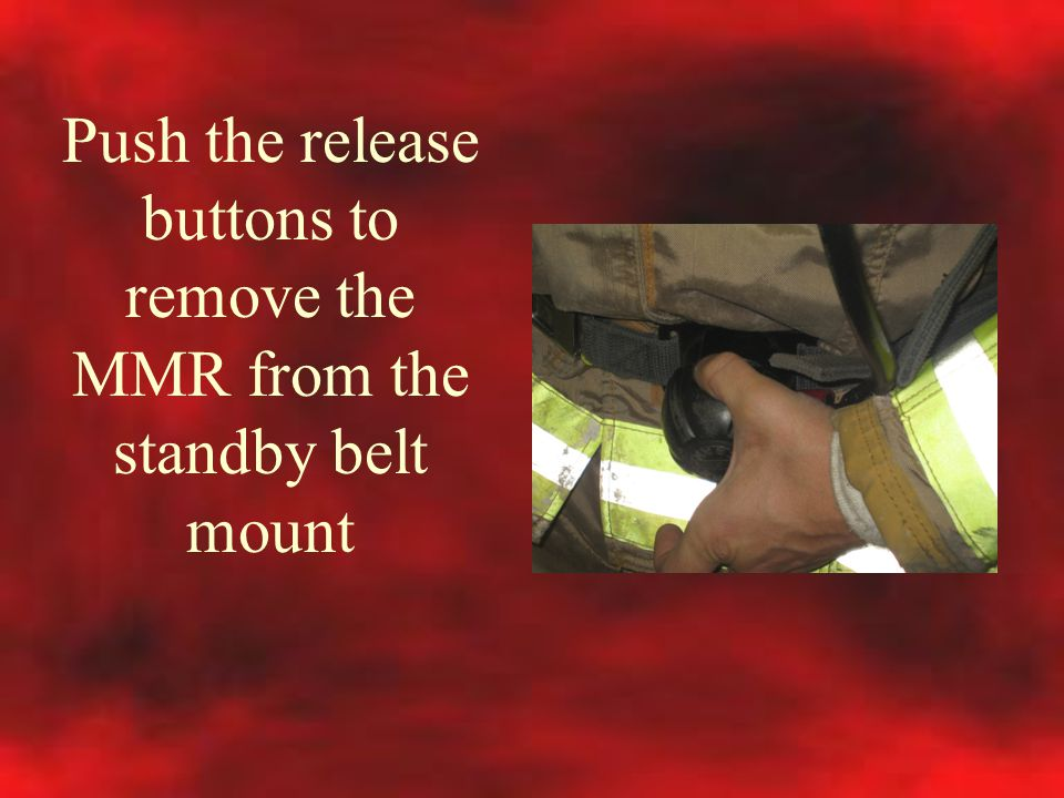 Push the release buttons to remove the MMR from the standby belt mount