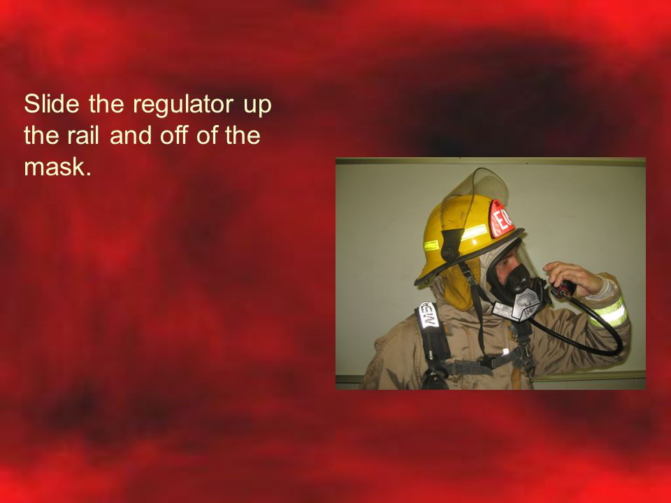 Slide the regulator up the rail and off of the mask.