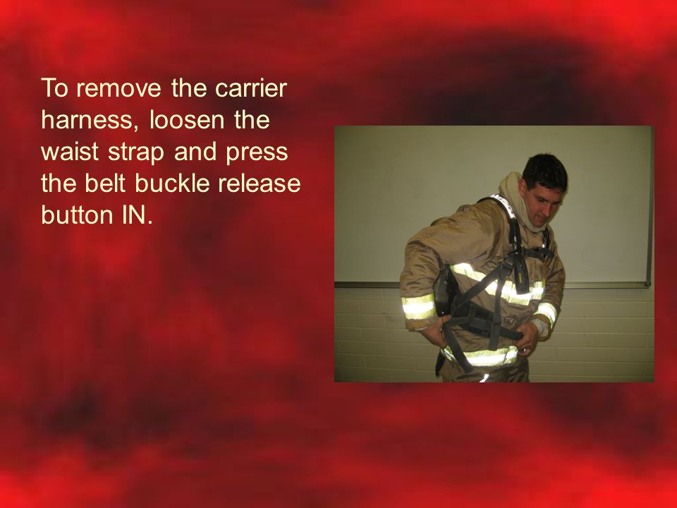 To remove the carrier harness, loosen the waist strap and press the belt buckle release button IN.