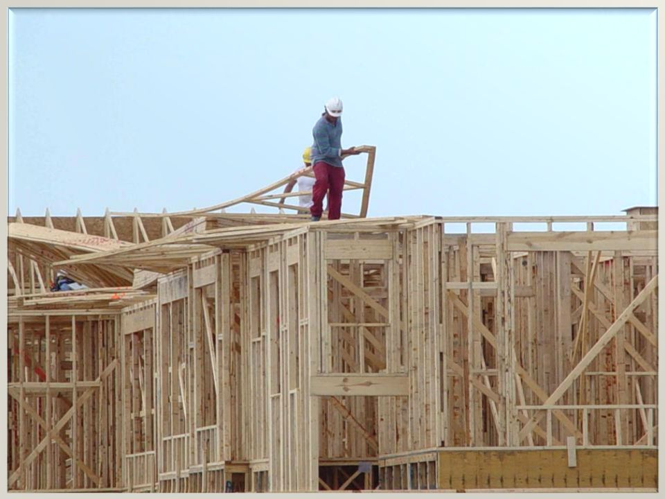 Roofers installing trusses with no Fall Protection