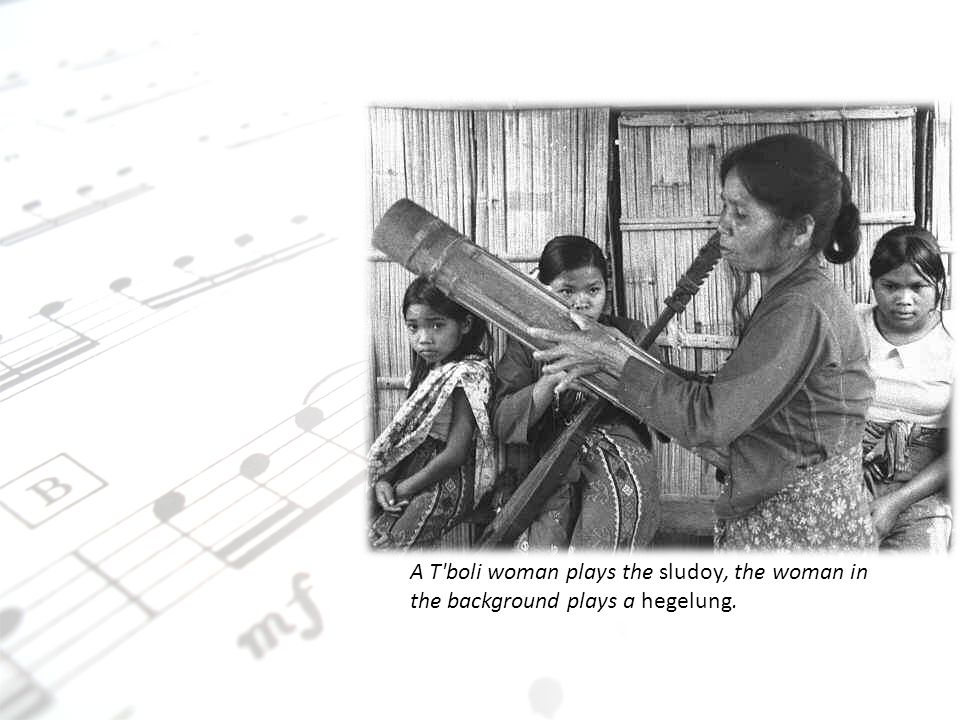 A T boli woman plays the sludoy, the woman in the background plays a hegelung.