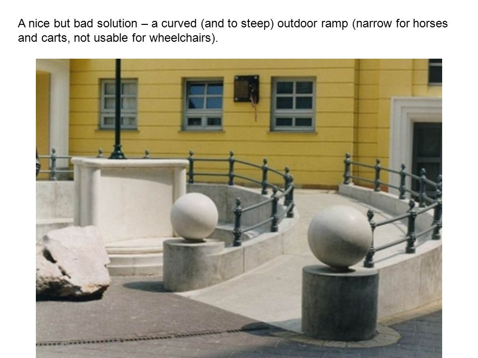 A nice but bad solution – a curved (and to steep) outdoor ramp (narrow for horses and carts, not usable for wheelchairs).
