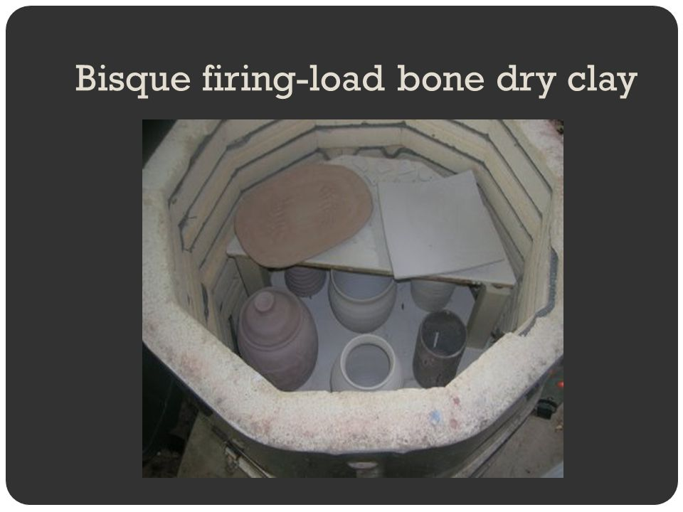 Bisque firing-load bone dry clay