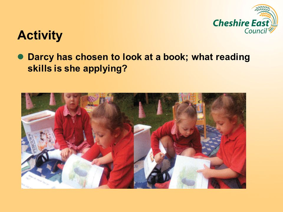 Activity Darcy has chosen to look at a book; what reading skills is she applying.