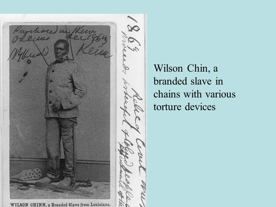 Wilson Chin, a branded slave in chains with various torture devices
